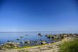 Leinwanddruck Bild - Rocky beach in the hot summer morning