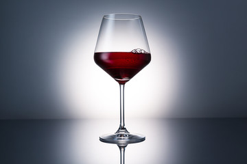 Red wine glass with dew