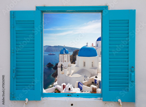 Fototapeta window with view of caldera and church, Santorini