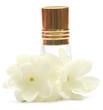 Jasmine flower with perfume bottle