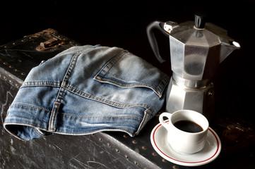 Espresso coffee, espresso maker and dirty jeans