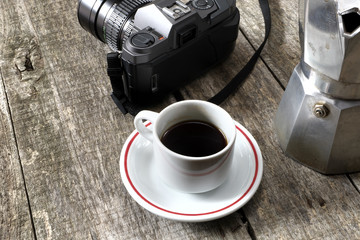 Espresso coffee, espresso maker and vintage camera