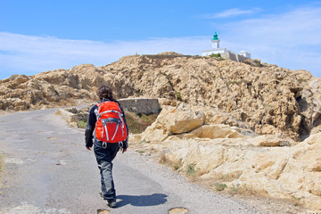 Adventurous girl on the way to the Lighthouse, Corsica, France