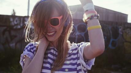Teenage girl listening to music through headphones