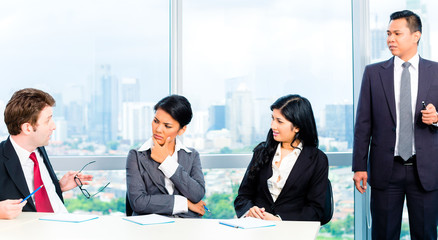 Asian Businesspeople in office team meeting