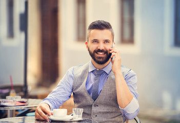Hipster businessman in cafe