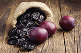 Prunes with plums in small sack