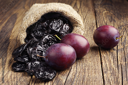 Fotobehang Keuken Prunes with plums in small sack