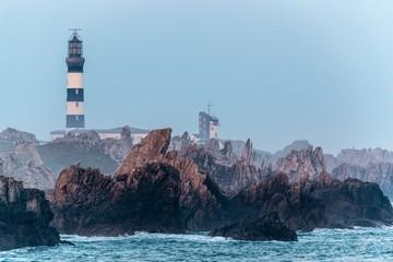 Sharp rocky coastline and lighthouse