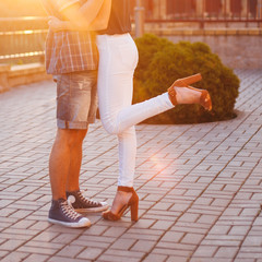 Male and female legs in sunshine during a date