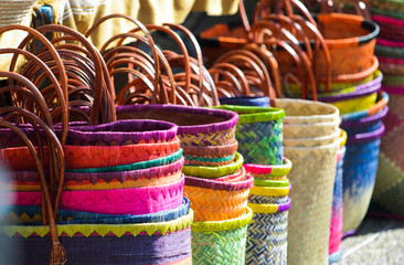 Multi-colored bags on a market stall