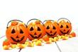 Row of Halloween Jack o Lantern candy holders with candy on wood