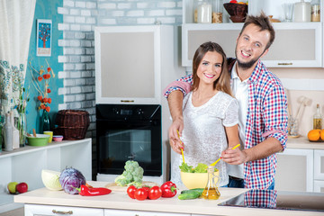 Family kitchen. Young and beautiful loving couple and help each