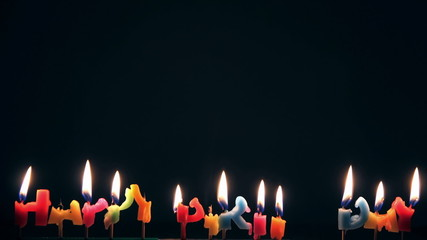 Time Lapse of Happy Birthday's candles on black