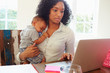 Mother With Baby Working In Office At Home - 70644960