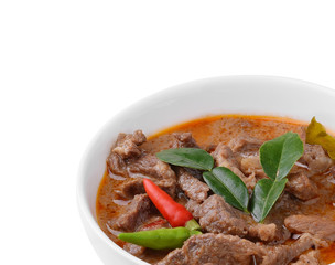 Panang curry with pork on white background