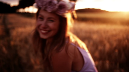 Girl being happy and silly in wheat field