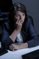 Frightened woman in the office