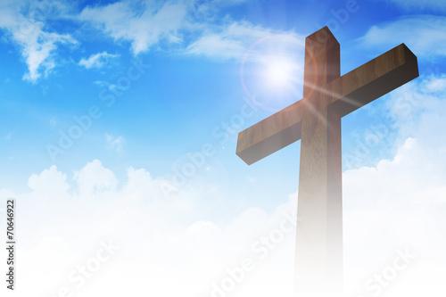 Naklejka A cross on clouds background
