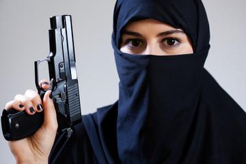 Muslim female terrorist holding handgun