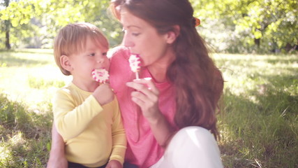 Mother and son enjoying 'i love you' lollipops