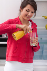 Girl pouring orange juice