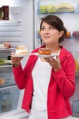 Girl holding plates with cakes