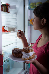 Hungry woman in the kitchen