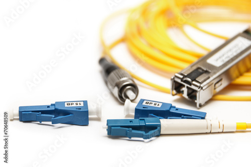 Optic fiber with connector isolated on white - 70648509