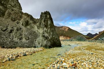 Green rock and creek