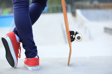 skateboarder woman legs at skatepark