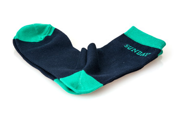 Isolated wool socks with inscription SUNDAY