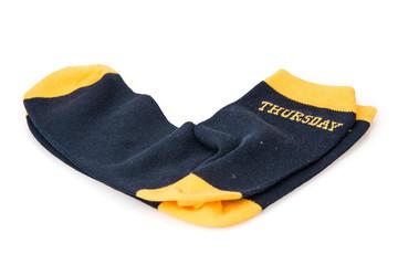 Isolated wool socks with inscription THURSDAY