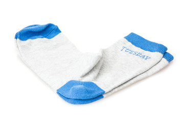Isolated wool socks with inscription TUESDAY