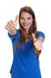canvas print picture - Blonde Frau mit blauem Shirt zeigt beide Daumen