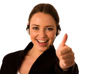 Preety happy asian caucasian business woman with headset showing