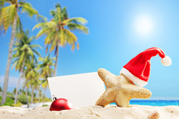 Starfish with Santa hat and banner on a beach