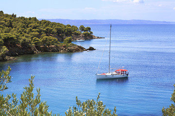 Yacht in the bay of the Aegean Sea.