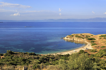 Wild sandy beach in the beautiful bay of the Aegean Sea.
