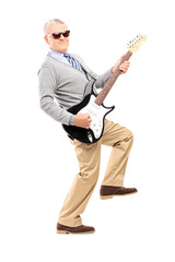 Cool senior playing an electric guitar