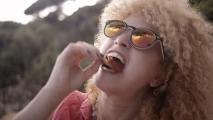 Girl enjoying a slice of pizza