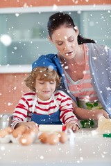 Composite image of beautiful mother and her son baking at home
