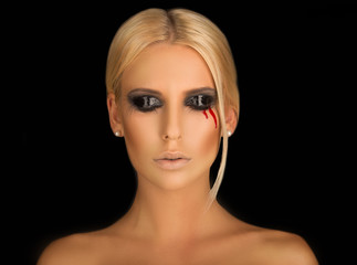 portrait of a beautiful blonde with creative make-up on