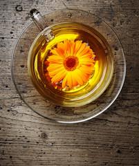 marigold tea on a wooden table