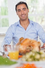 Man sitting at head of dinner table