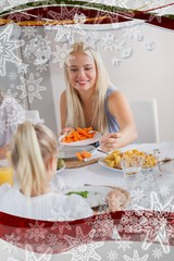 Mother handing carrots to daughter at dinner
