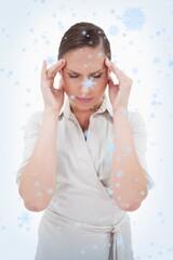 Portrait of a businesswoman having a headache