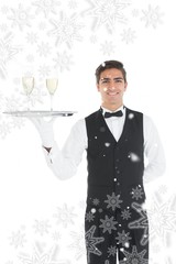 Young waiter presenting a silver tray