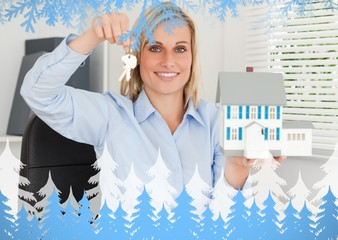 Businesswoman presenting model house and keys