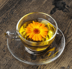 marigold tea on an old wooden table